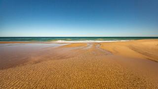 Maslings beach with water stream.jpg