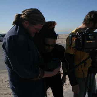 Writer Michael Daniel shields RR so he can check the shot