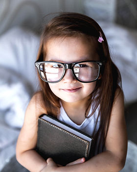 preschooler-girl-with-books-and-glasses-