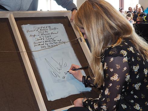 Mikaela Shiffrin signing my artwork