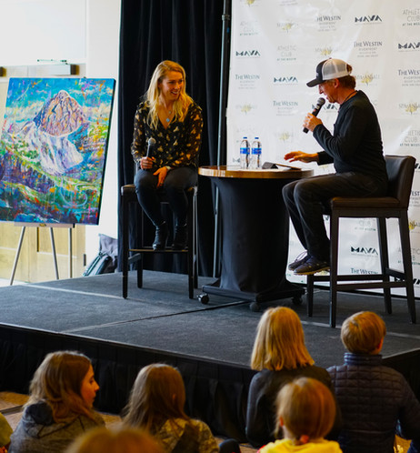 Chris Anthony interviewing Mikaela Shiffrin with my artwork in the background