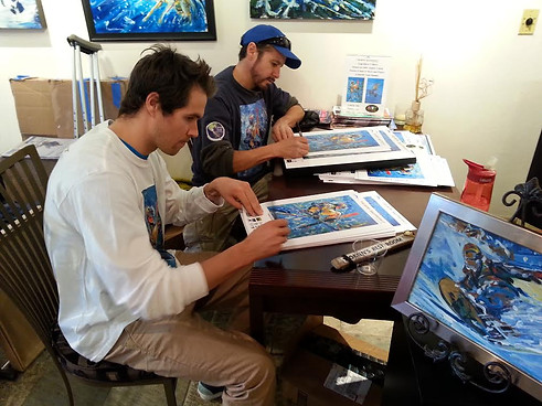 Olypmic Free Style Skier and X-Game gold medalist, Bobby Brown and I signing posters for Team Summit