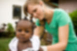 NGO-Medical-Worker-Helping African-Child