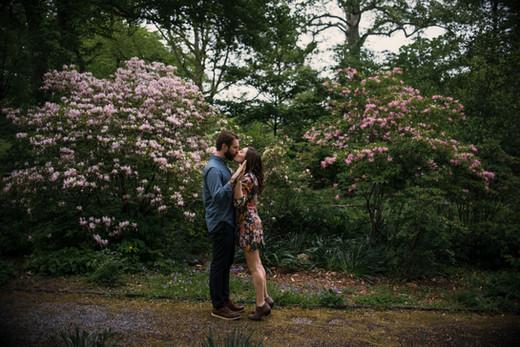 bartrams garden engagement shoot philadelphia photographer nature flower bush kiss