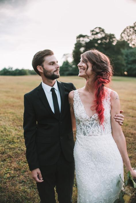 husband and wife in a field newlyweds philadelphia photographer