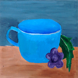 """Title: """"Blue cup on table next to leaf"""""""