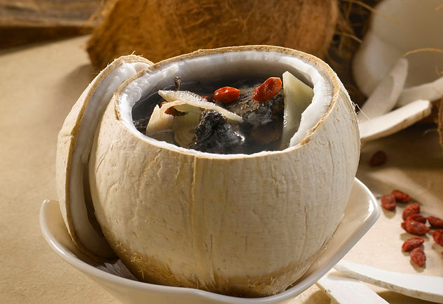 Double-Boiled Whole Coconut with Black Chicken Soup