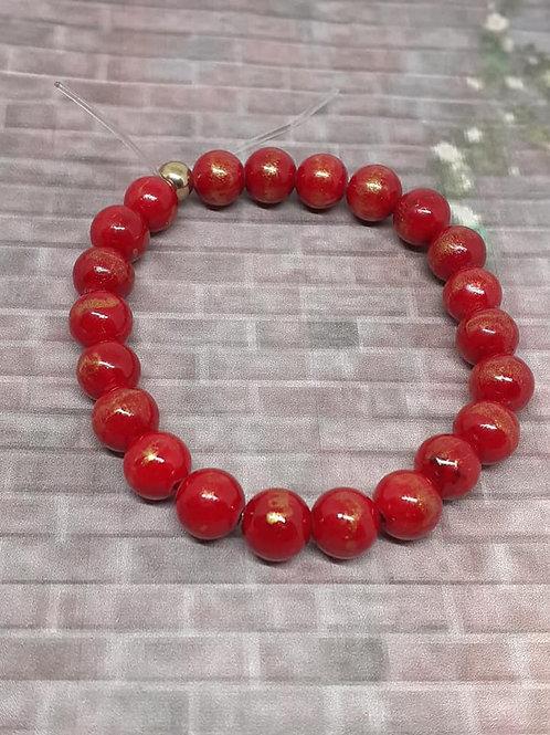 Bracelet Jade Mashan rouge poudre d'or