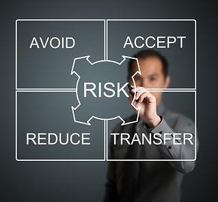 businessman writing risk management conc