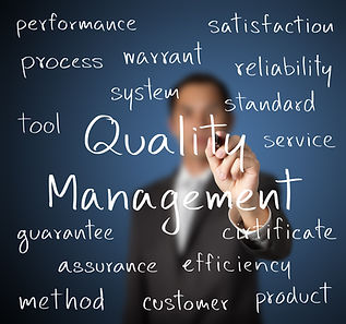 business man writing quality management