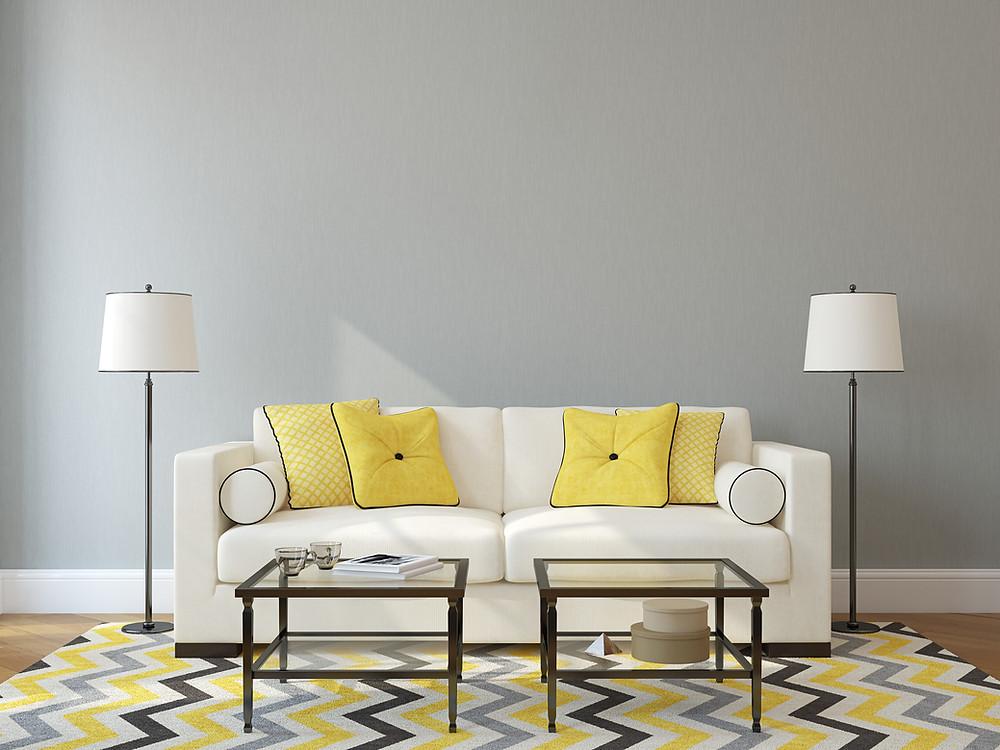 White sofa with yellow pillows