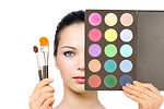 Color pallet with makeup brushes