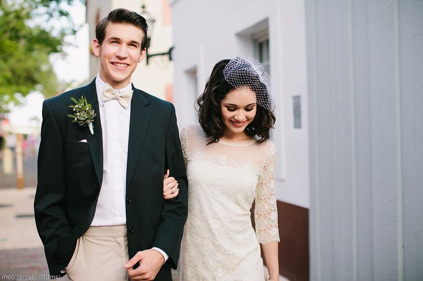 Bride and groom walking arm in arm