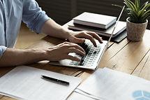 Close up businessman using laptop, typin