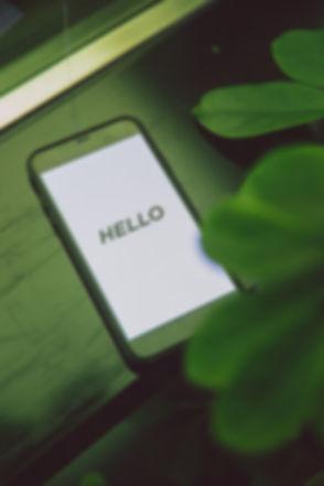 black-iphone-5-on-table-3747142.jpg