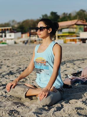 mockup-of-a-woman-wearing-a-tank-top-while-meditating-at-the-beach-38130-r-el2.png
