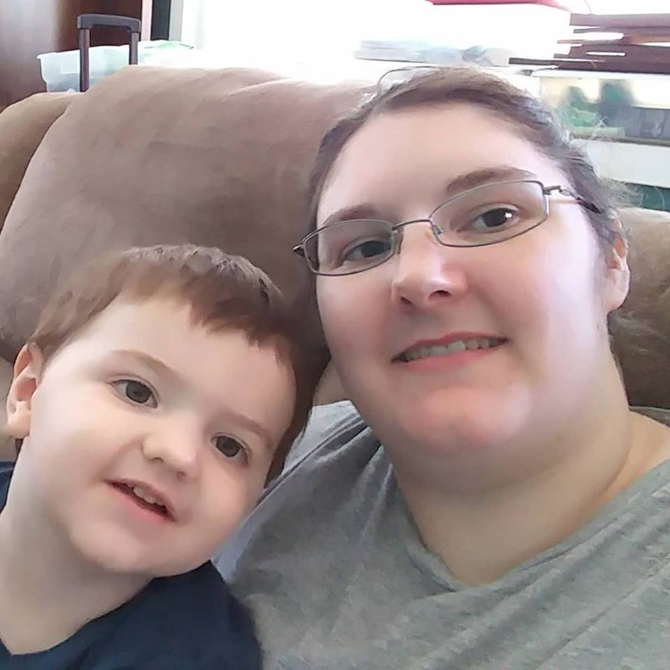 Myself and my son, Elijah sitting in our new house!