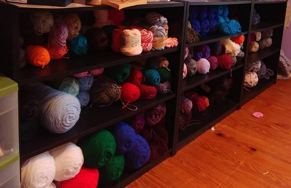 Short bookcases with yarn in them