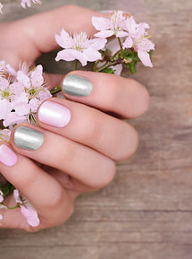 Female hands with pink and silver nail d