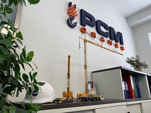About PCM Cranes.jpg