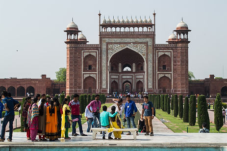 A couple taking picture at the Taj Mahal in India