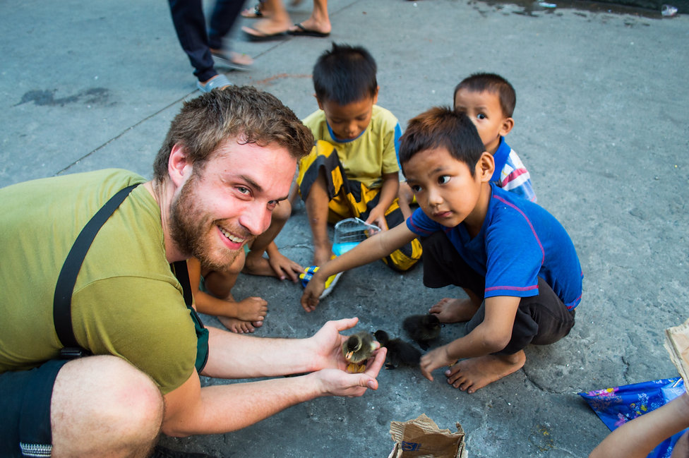 Kids with ducklings in Manila, Philippines