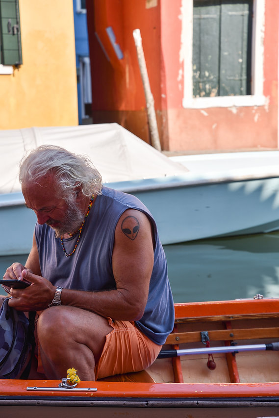 a man and his boat in Burano, Venice, Italy