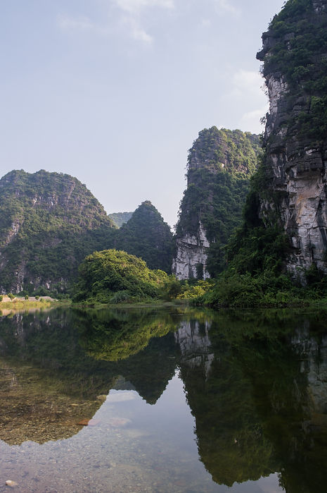 Lime stone formations and reflection in Tam Coc, Vietnam