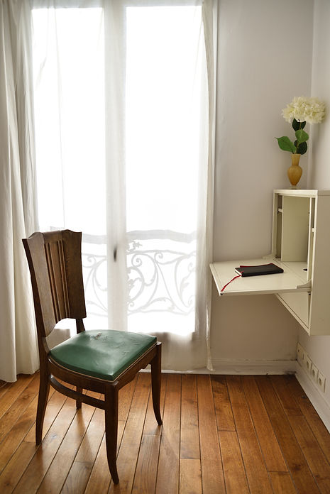 Bedroom with desk in a Parisian apartment
