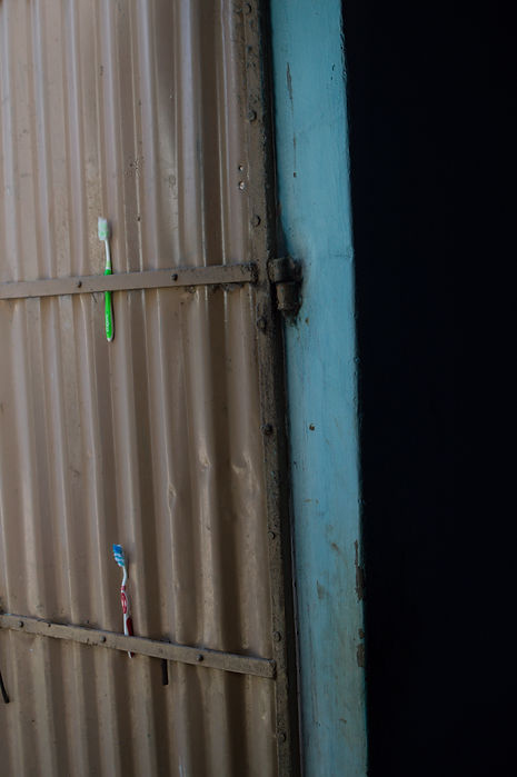 Toothbrushes pinned to a door in Tamil Nadu, India