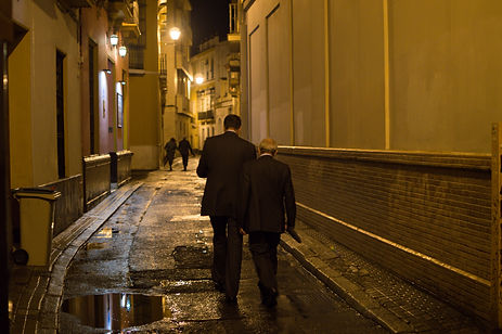 Two business men in the streets of Seville, Spain at night