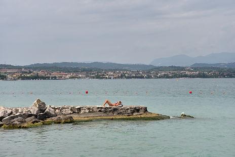 sunbathing at Lake Garda in Italy