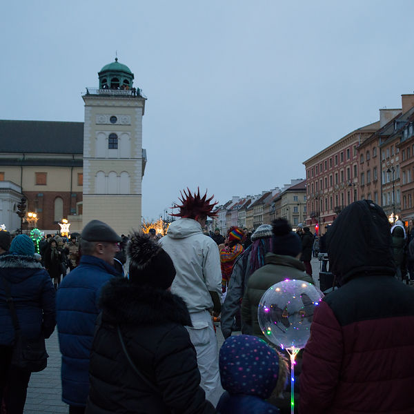 People watching street musicians in Warsaw, Poland
