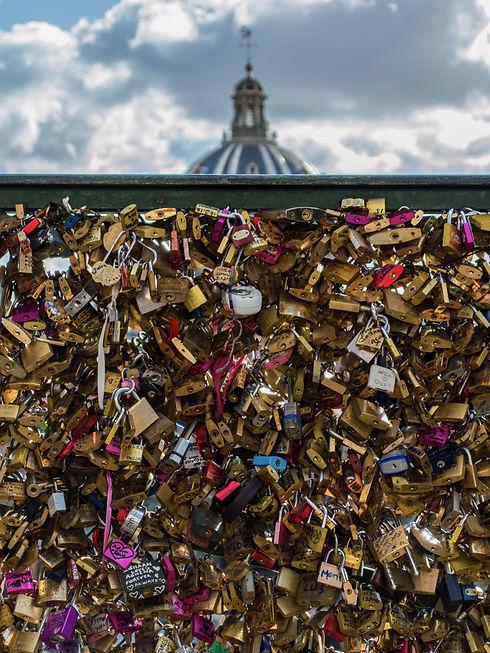 Love padlocks at a bridge by the Seine in Paris, France