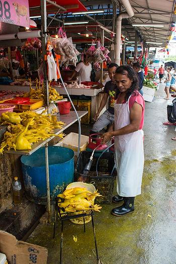 Frying chicken on a market in Kuala Lumpur, Malaysia