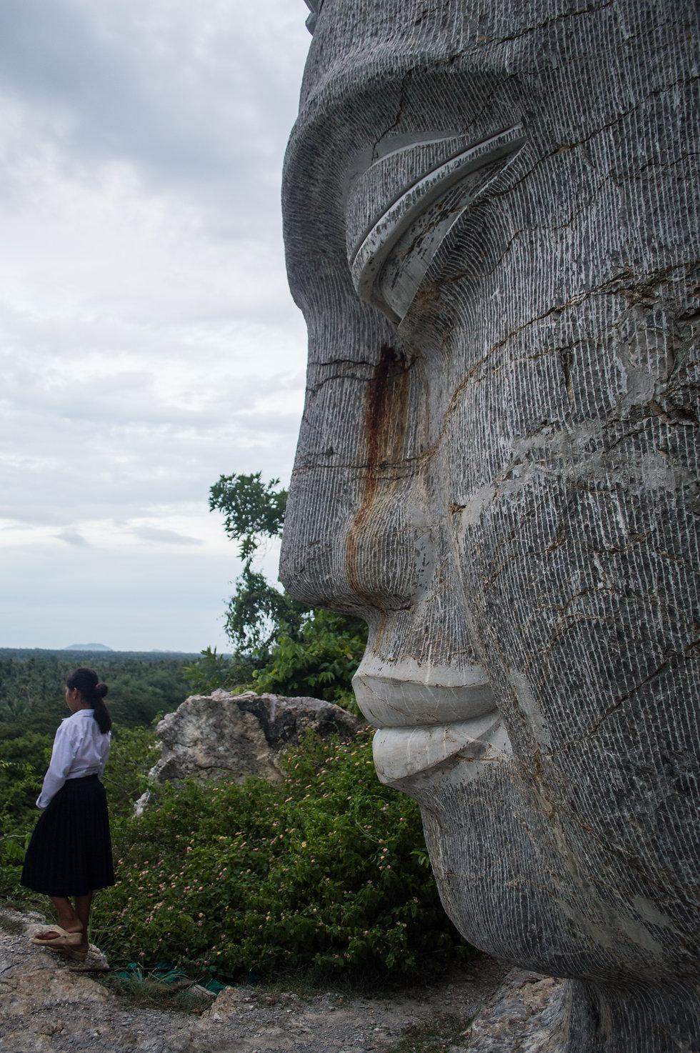 Buddha sculpture in stone, Battambang, Cambodia