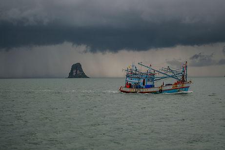 A fishing boat and heavy rain off Ko Pha Ngan, Thailand