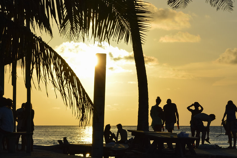 Tourists enjoying a sunset in Caye Caulker, Belize
