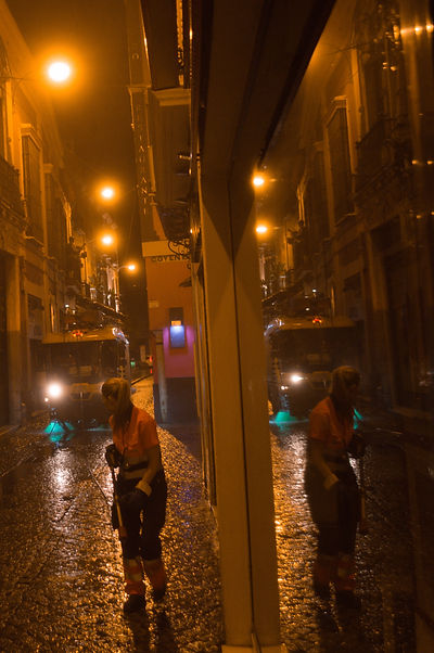 Cleaning the streets of Seville, Spain at night