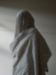 person wrapped in bed sheet