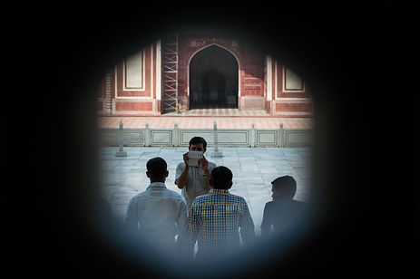 A group of men taking pictures at the Taj Mahal, Agra, India