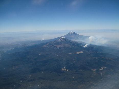 Aerial of volcanoes near Mexico City