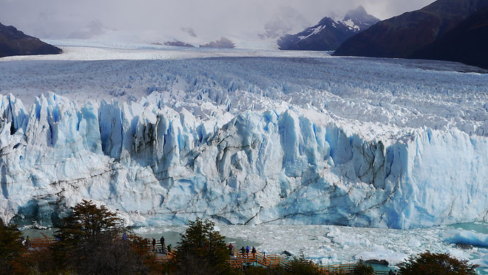 People in front of Perrito Moreo Glacier in Patagonia, Argentina