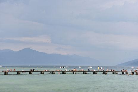 tourists sunbathing at Lake Garda in Italy