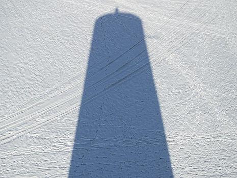 Shadow of Burana Tower in winter