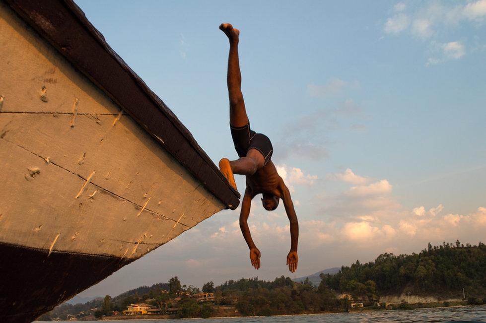 Man headjumping into Lake Kivu in Rwanda