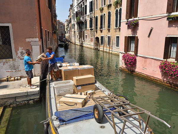 delivering mail by boat in Venice, Italy