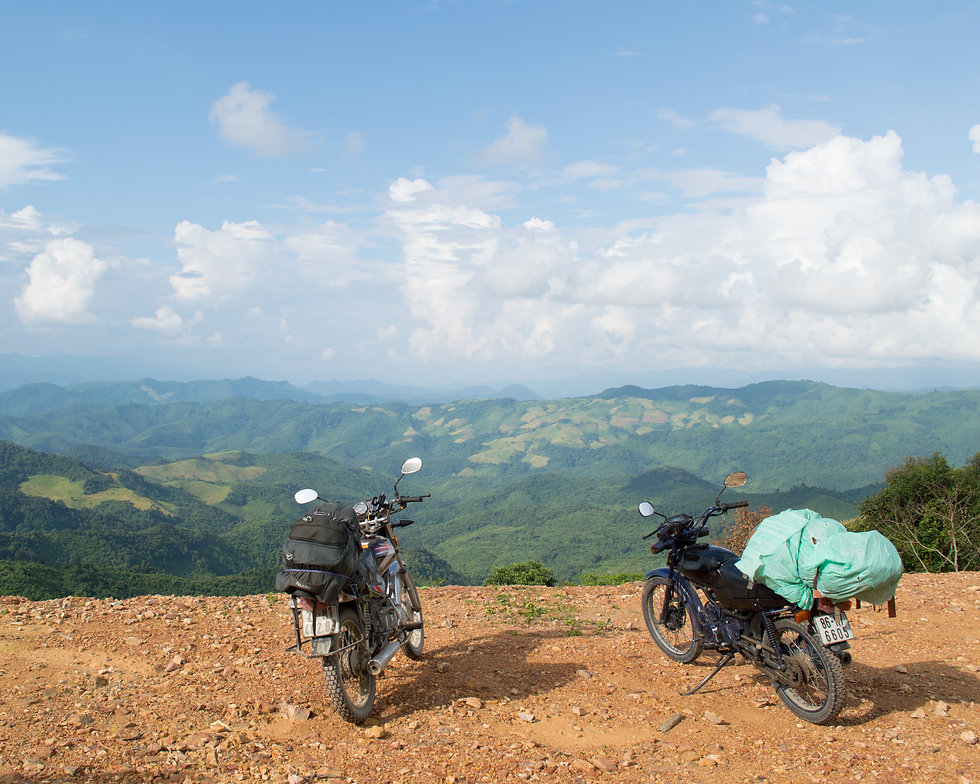 Motorcycles in front of a lookout in Laos