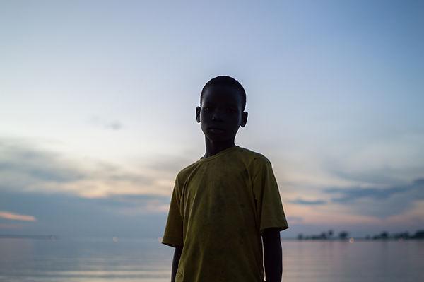 Boy in front of Lake Victoria, Uganda