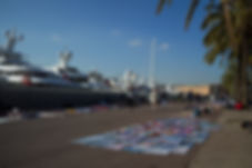 African vendors in front of yachts in Barcelona